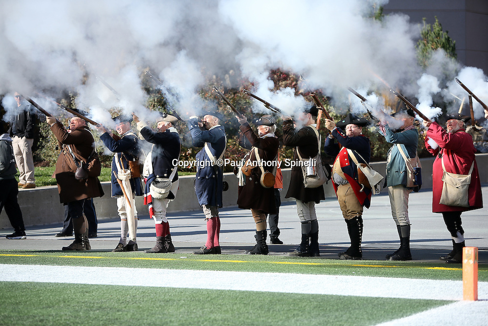 The New England End Zone Militia fire their muskets after a touchdown during the New England Patriots 2015 week 9 regular season NFL football game against the Washington Redskins on Sunday, Nov. 8, 2015 in Foxborough, Mass. The Patriots won the game 27-10. (©Paul Anthony Spinelli)