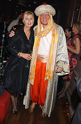MARIA KEMPINSKA founder of Jongleurs and RICHARD TAYLOR at a party to celebrate the recent merger of Chelsea Mortgage Management with Cobalt Capital - A Night in Marrakesh held at Raffles, nightclub, Kings Road, London on 1st December 2005.<br />