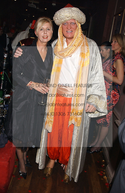 MARIA KEMPINSKA founder of Jongleurs and RICHARD TAYLOR at a party to celebrate the recent merger of Chelsea Mortgage Management with Cobalt Capital - A Night in Marrakesh held at Raffles, nightclub, Kings Road, London on 1st December 2005.<br /><br />NON EXCLUSIVE - WORLD RIGHTS