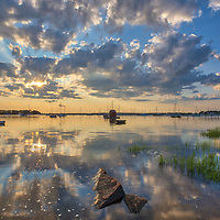 Cape Cod sunsets hardly disappoint. I caught this beautiful end of day light reflection and Cape Cod sunburst at the Dimmick Waterfront Scenic Vista in Bourne, MA.<br />   <br /> Cape Cod photography images are available as museum quality photography prints, canvas prints, acrylic prints or metal prints. Fine art prints may be framed and matted to the individual liking and decorating needs:<br /> <br /> https://juergen-roth.pixels.com/featured/dimmick-waterfront-scenic-vista-juergen-roth.html<br /> <br /> All Cape Cod digital photography image licensing is available at www.RothGalleries.com. Please contact Juergen with any questions or request. <br /> <br /> <br /> Good light and happy photo making!<br /> <br /> My best,<br /> <br /> Juergen<br /> Licensing: http://www.rothgalleries.com<br /> Instagram: https://www.instagram.com/rothgalleries<br /> Twitter: https://twitter.com/naturefineart<br /> Facebook: https://www.facebook.com/naturefineart