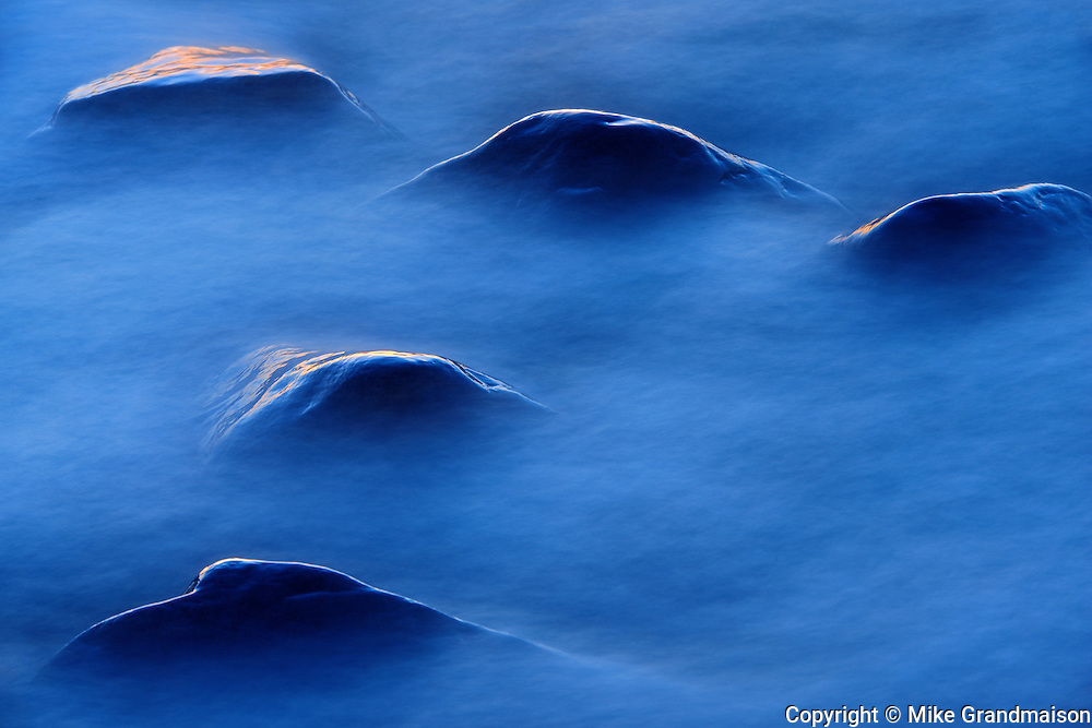 Waves crashing on rocks off the shoreline of Lake Winnipeg at dusk<br /> Hillside Beach<br /> Manitoba<br /> Canada