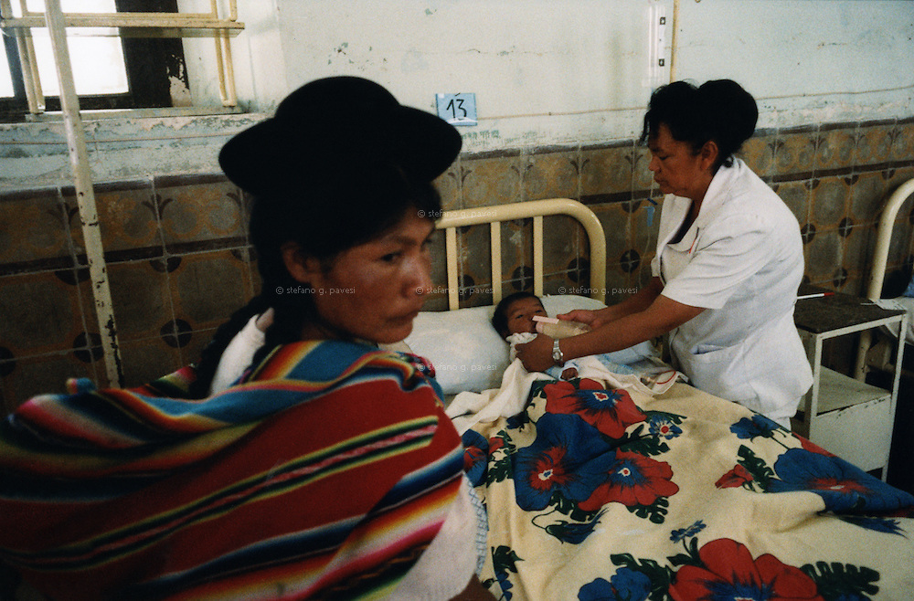 Bolivia , Cochabamba , February 1999 - City hospital : mother and son.<br /> <br /> <br /> Operation Smile is a private, not-for-profit volunteer medical services organization providing reconstructive surgery and related health care to indigent children worldwide.