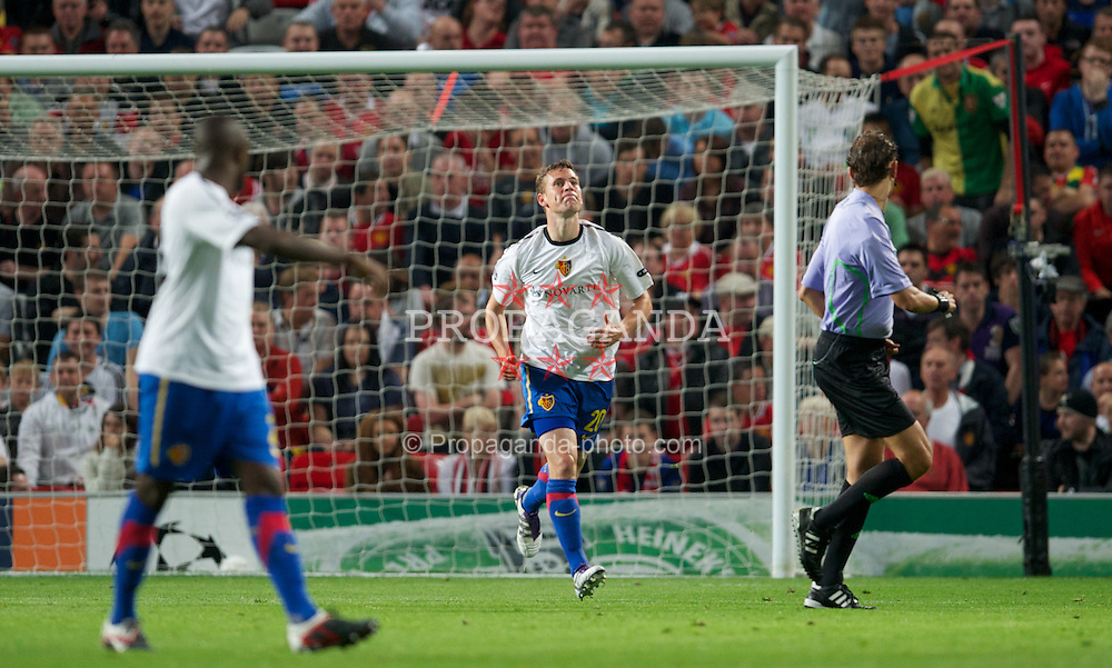 MANCHESTER, ENGLAND - Tuesday, September 27, 2011: FC Basel 1893's Fabian Frei looks dejected after missing an early chance against Manchester United during the UEFA Champions League Group C match at Old Trafford. (Pic by David Rawcliffe/Propaganda)