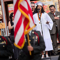 051614       Cable Hoover<br /> <br /> Gallup High School senior Danielle Hutchinson sings the national anthem to kick off the GHS commencement ceremony at Red Rock Park Saturday.