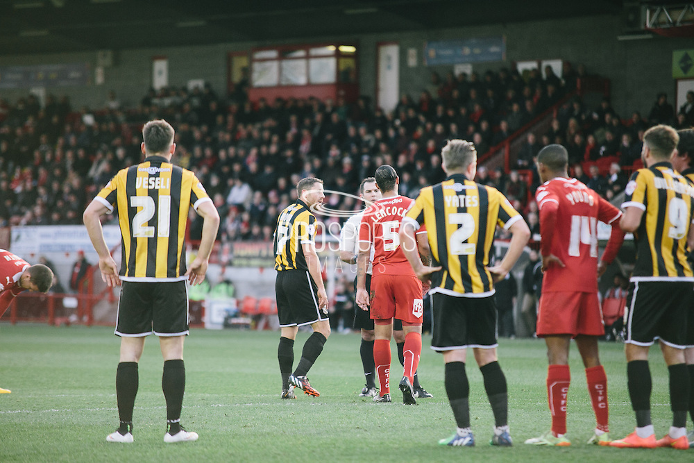 Vale's Birchall and Crawley's leacock reprimanded by referee tim robinson during the Sky Bet League 1 match between Crawley Town and Port Vale at Broadfield Stadium, Crawley, England on 20 December 2014. Photo by Sam Shaw.