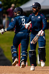 September 22, 2018 - Morrisville, North Carolina, US - Sept. 22, 2018 - Morrisville N.C., USA - Team USA JASKARAN MALHA (4) and STEVEN TAYLOR (8) score during the ICC World T20 America's ''A'' Qualifier cricket match between USA and Canada. Both teams played to a 140/8 tie with Canada winning the Super Over for the overall win. In addition to USA and Canada, the ICC World T20 America's ''A'' Qualifier also features Belize and Panama in the six-day tournament that ends Sept. 26. (Credit Image: © Timothy L. Hale/ZUMA Wire)