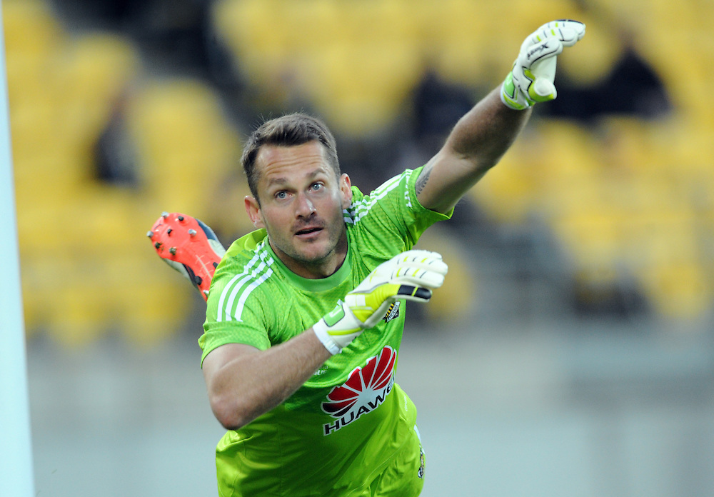 Phoenix's Glen Moss makes a diving save against Adelaide United in the A-League football match at Westpac Stadium, Wellington, New Zealand, Friday, November 13, 2015. Credit:SNPA / Ross Setford
