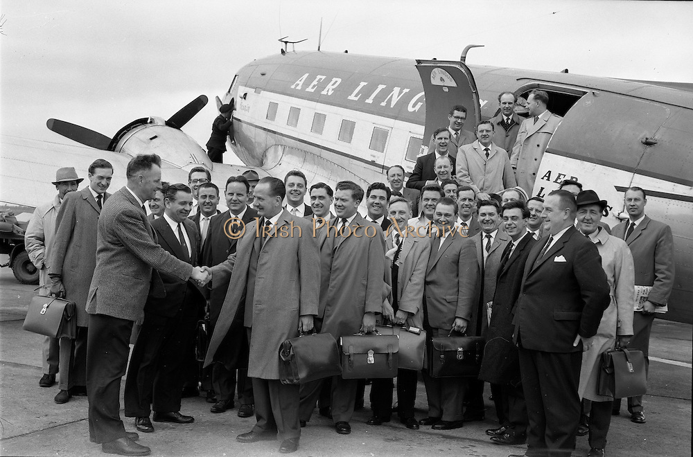 27/05/1962<br /> 05/27/1962<br /> 27 May 1962<br /> Irish Cider and Perry Company Salesmen arrive at Dublin Airport. Forty salesmen flew into Dublin to join the Irish repesentatives of the Irish Cider and Perry Company in launching the new Irish produced Babycham and Coates' vintage cider throughout Ireland. Both products were made at the newly acquired Bulmers Ltd. factory at Clonmel. The salmon were to visit 10,200 premises. The party arrived from Bristol on an Aer Lingus Charter plane and were assigned a car each. Picture shows Mr Edward Dix, General Salesmanager and members of the group being welcomed on their arrival at Dublin Airport by Mr John Kelly, General Manager of the I.C.P.C.