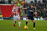 Leeds United defender Luke Ayling (2) goes past Stoke City midfielder Sam Clucas  (22) during the EFL Sky Bet Championship match between Stoke City and Leeds United at the Bet365 Stadium, Stoke-on-Trent, England on 19 January 2019.
