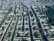 Nederland, Amsterdam, Oud-West, 17-10-2005; luchtfoto (25% toeslag); Overtoom (rechtsonder naar boven), Eerste Helmersstraat (links van de Overtoom) gevolgd door: Brederodestraat, Wilhelminastraat, Kanaalstraat en Jacob van Lennepkade / Van Lennepkanaal (vlnr); boven het midden het voormalige Wilhelmina Gasthuis terrein (WG terrein, voormalig ziekenhuis, nu AMC),  Vondelpark met Parkkerk en Vondelkerk (midden rechts), in de achtergrond de binnenstad; gesloten bouwblok, stadsvernieuwing, achterstandsbuurt, achterstandswijk, geboortehuis W.F. Hermans (Eerste Helmersstraat).foto Siebe Swart