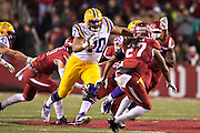 FAYETTEVILLE, AR - NOVEMBER 15:  La'el Collins #70 of the LSU Tigers blocks down field during a game against the Arkansas Razorbacks at Razorback Stadium on November 15, 2014 in Fayetteville, Arkansas.  The Razorbacks defeated the Tigers 17-0.  (Photo by Wesley Hitt/Getty Images) *** Local Caption *** Anthony Jennings; La'el Collins