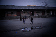 Youngh migrants are seen playing volleyball in the train station wearhouses makeshiftcamp. Many of the 900 migants living in the camp are unaccompained minors trying to reach their relatives already living in Europe. March 16th 2017, Belgrade, Serbia. Federico Scoppa/CAPTA