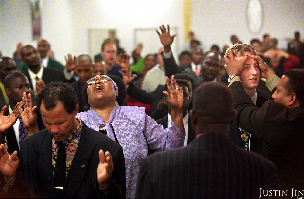 Former drug addicts, prostitutes and criminals pray at the Amsterdam Church...Victory Outreach, a controversial church started in Los Angeles in 1967, is spreading to Europe via the Netherlands. It builds its membership among junkies, prostitutes and criminals. ..Photo taken in the Netherlands in 2002. The picture is part of a photo and text documentary by Justin Jin. For more information, email justin@justinjin.com