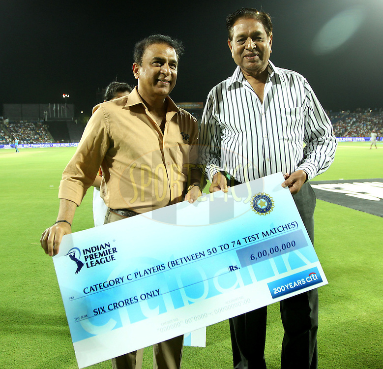 Sunil Gavaskar Gives an award to Chandu Borde Former cricketer during the first Qualifying match of the Indian Premier League ( IPL) 2012  between The Delhi Daredevils and The Kolkata Knight Riders held at the Subrata Roy Sahara Stadium, Pune on the 22nd May 2012..Photo by Sandeep Shetty/IPL/SPORTZPICS