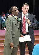 HISD Superintendent Terry Grier, right, recognizes Atherton Principal Dr. Albert Lemons at the school's dedication on Friday, Sept. 6.