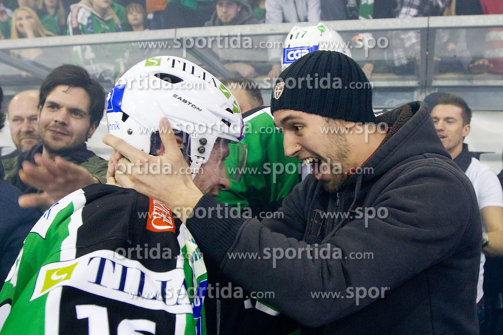 Ziga Pance (HDD Tilia Olimpija, #19) and Ales Music (HDD Tilia Olimpija, #16) celebrates during ice-hockey match between HDD Tilia Olimpija and SAPA Fehervar AV19 at sixth match in Quarterfinal  of EBEL league, on March 1, 2012 at Hala Tivoli, Ljubljana, Slovenia. HDD Tilia Olimpija won 4:3. (Photo By Matic Klansek Velej / Sportida)