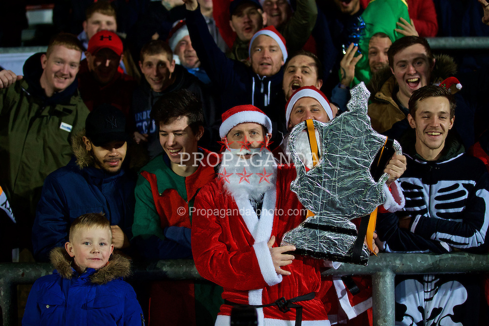 NEWPORT, WALES - Wednesday, December 21, 2016: A Newport County supporter dressed as Father Christmas with a tin foil cardboard cut-out FA Cup during the FA Cup 2nd Round Replay match against Plymouth Argyle at Rodney Parade. (Pic by David Rawcliffe/Propaganda)