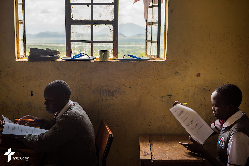 A young student (right) from the U-Dom ELCK Project 24 site takes an exam at Propoi Girls Secondary School, a school sponsored by the ELCK (Evangelical Lutheran Church in Kenya), on Thursday, June 23, 2016, in Chepareria, Kenya.  LCMS Communications/Erik M. Lunsford