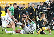 Hurricanes' Julian Savea lands awkwardly after a tackle from Highlanders' Waisake Naholo during the Round 14 Super Rugby match, Hurricanes v Highlanders at Westpac Stadium, Wellington. 27th May 2016. Copyright Photo.: Grant Down / www.photosport.nz