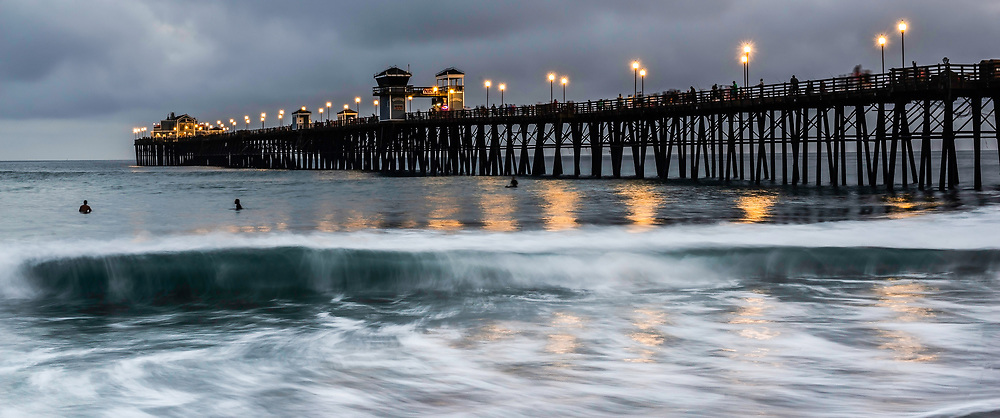 Early Evening Surf Session At Oceanside Pier