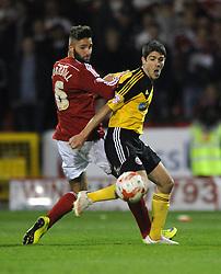 Sheffield United's Ryan Flynn challenges Swindon Town's Jordan Turnbull - Photo mandatory by-line: Dougie Allward/JMP - Mobile: 07966 386802 - 11/05/2015 - SPORT - Football - Swindon - County Ground - Swindon Town v Sheffield United - Sky Bet League One - Play-Off