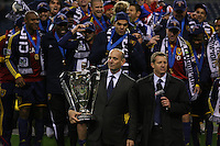 SEATTLE - NOVEMBER 22:  Don Garber holds the MLS CUP as the  Real Salt Lake team celebrate their victory against the  Los Angeles Galaxy in the MLS Cup final at Qwest Field on November 22, 2009 in Seattle, Washington. (Photo by Tom Hauck)