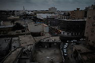 Streets of downtown Misrata at dusk showing little outside activity. 08 June 2011.