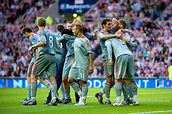 SUNDERLAND, ENGLAND - Saturday, August 16, 2008: Liverpool players mob match-winner Fernando Torres after his late goal beat Sunderland during the opening Premiership match of the season at the Stadium of Light. (Photo by David Rawcliffe/Propaganda)