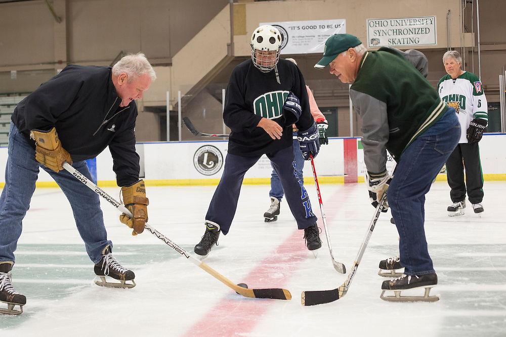 Hockey alumni attempt to reenact a play from the 1960s during their reunion at Bird Arena on October 1, 2016.
