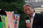 A politician with the opposition, DPJ (Democratic Party Of Japan) speaks at a demo outside the Japanese parliament building against Prime Minister, Shinzo Abe and his reinterpretation of Article 9 of the Japanese Constitution. Nagatacho, Tokyo, Japan. Friday July 17th 2015. Around 10,000 people took part to protest a change in the law that would allow collective self-defence which was ratified in the Lower House on Thursday. Many fear this new interpretation of Japan's unique peace constitution will mean Japanese soldiers being sent to war, to aid allies such as America,