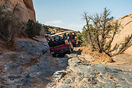 4x4 Hummers on a tour on the Hell's Revenge Trail in the Sandflats Recreation Area near Moab, Utah.