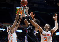 Dec 20, 2011; Knoxville, TN, USA; North Carolina-Asheville Bulldogs forward Jeremy Atkinson (15) battles for the ball against the Tennessee Volunteers during the second half at Thompson Boling Arena. Mandatory Credit: Randy Sartin-US PRESSWIRE