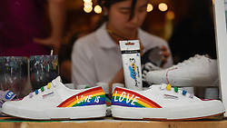 © Licensed to London News Pictures. 29/06/2018. LONDON, UK.  A shoe shop in Carnaby Street joins other stores in the Oxford Street area with a rainbow makeover in support of the Pride Festival, a worldwide celebration of the LGBT community.  The popular annual Pride London parade takes place in the capital on 7 July.  Photo credit: Stephen Chung/LNP