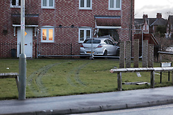 © Under licence to London News Pictures. 10/01/2017. A family, who were all upstairs sleeping, had a lucky escape when a car crashed into the front of their house in Railway View, Darlington, County Durham. The incident happened at 3 am and the driver was arrested on suspicion of driving under the influence. Photo Credit: Stuart Boulton/LNP