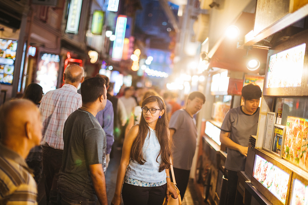 An outdoor food street at night in Chinatown, Singapore.