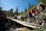 Riding Seven Bridges trail in Mammoth Mountain Bike Park.