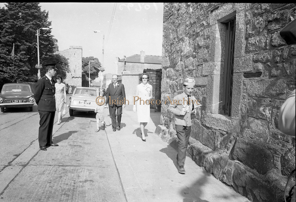 T F O'Higgins, a candidate in the 1966 Presidential Election, casts his vote at Dalkey Town Hall, accompanied by his wife,  and two of his sons, Shane (left), and Michael (right). O'Higgins came within 1% (or 10,000 votes) of defeating outgoing president Eamon de Valera. <br /> 01.06.1966