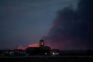 Cubillo de Uceda village and its church are seen in front of a forest fire, on August 11, 2012 in Guadalajara, Spain. During a heat wave dozens of forest fires have appeared in Spain, three of them at National Parks, like Teide, Doñana or Cabañeros, and thousands of people had to be evacuated at La Gomera and Tenerife, in the Canary Islands.