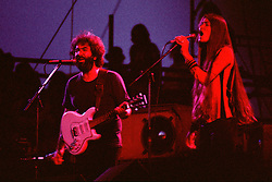 The Grateful Dead Live in Concert at Roosevelt Stadium on 4 August 1976. Jerry Garcia and Donna Jean Godchaux Singing during the First Set. No Record of which Song. But it's possible to determine from Show Setlist/Playback.