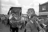 A black draped Kellingley Colliery banner, 1985 Yorkshire Miner's Gala. Rotherham.