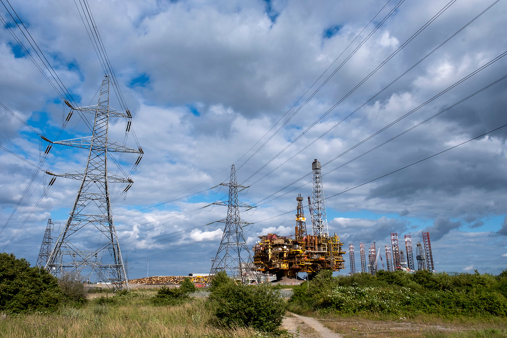 Electricity Pylons leading from Hartlepool Power Station pass the decommissioned Brent Delta Oil Rig in Able Seaton Port, Hartlepool, North East England, UK.  (photo by Andrew Aitchison / In pictures via Getty Images)