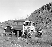 "Gordon MacQuarrie (r) and photographer Jim Meyer, with the Milwaukee Journal ""Gordon MacQuarrie"" Jeep Wagoneer in September, 1946."