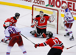 March 19, 2008; Newark, NJ, USA;  New Jersey Devils goalie Martin Brodeur (30) makes a glove save on New York Rangers right wing Jaromir Jagr (68) during the third period at the Prudential Center.
