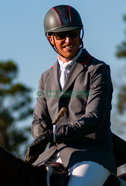 March 22, 2019 - Raeford, North Carolina, US - March 22, 2019 - Raeford, N.C., USA - DOUG PAYNE of the United States relaxes in the warm-up area before competing in the CCI3-S show jumping division at the sixth annual Cloud 11-Gavilan North LLC Carolina International CCI and Horse Trial, at Carolina Horse Park. The Carolina International CCI and Horse Trial is one of North AmericaÃ•s premier eventing competitions for national and international eventing combinations, hosting International competition at the CCI2*-S through CCI4*-S levels and National levels of Training through Advanced. (Credit Image: © Timothy L. Hale/ZUMA Wire)