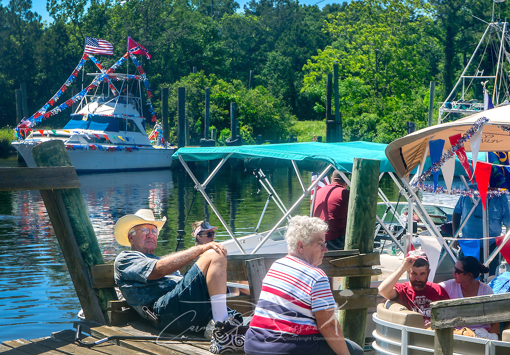 A crowd gathers, waiting for the 66th annual Blessing of the Fleet to begin in Bayou La Batre, Alabama, May 3, 2015. The first fleet blessing was held by St. Margaret's Catholic Church in 1949, carrying on a long European tradition of asking God's favor for a bountiful seafood harvest and protection from the perils of the sea. The highlight of the event is a blessing of the boats by the local Catholic archbishop and the tossing of a ceremonial wreath in memory of those who have lost their lives at sea. The event also includes a land parade and a parade of decorated boats that slowly cruise through the bayou. (Photo by Carmen K. Sisson/Cloudybright)