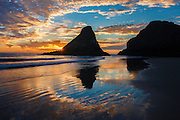 Sunset reflections on the beach at sunset on the Oregon Coast