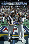 Admiral Fargo poses at the coin toss with Alternate Referee Bob McElwee and an American flag at the 2003 Pro Bowl, the NFL  All-Star Game at Aloha Stadium in Hawaii on 02/02/2003. The  AFC intercepted 6 passes to defeat the NFC for the third year in a row, this time by a score of 45 to 20. ©Paul Anthony Spinelli