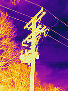 Thermogram of electrical wires on a telephone pole connected to a transformer. The different colors represent different temperatures on the object. The lightest colors are the hottest temperatures, while the darker colors represent a cooler temperature.  Thermography uses special cameras that can detect light in the far-infrared range of the electromagnetic spectrum (900?14,000 nanometers or 0.9?14 µm) and creates an  image of the objects temperature..
