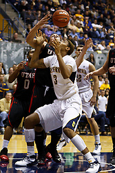 Jan 14, 2012; Berkeley CA, USA;  Utah Utes forward Javon Dawson (back) grabs a loose ball from California Golden Bears forward Richard Solomon (3) during the second half at Haas Pavilion. California defeated Utah 81-45. Mandatory Credit: Jason O. Watson-US PRESSWIRE