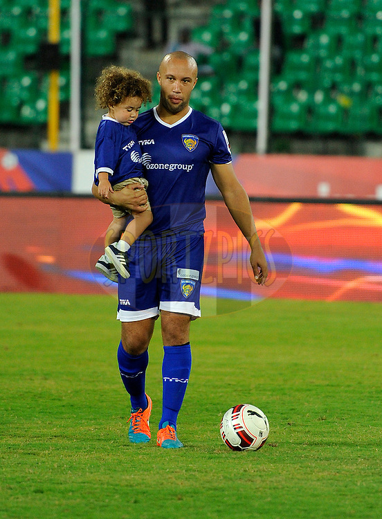 Mikael Silvestre of Chennaiyin FC walks back with his son and daughter during match 50 of the Hero Indian Super League between Chennaiyin FC and FC Goa held at the Jawaharlal Nehru Stadium, Chennai, India on the 5th December 2014.<br /> <br /> Photo by:  Pal Pillai/ ISL/ SPORTZPICS